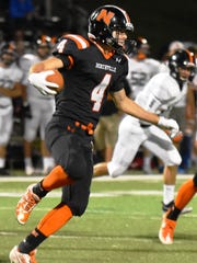 Northville's Jack Barnes (4) looks for an opening against