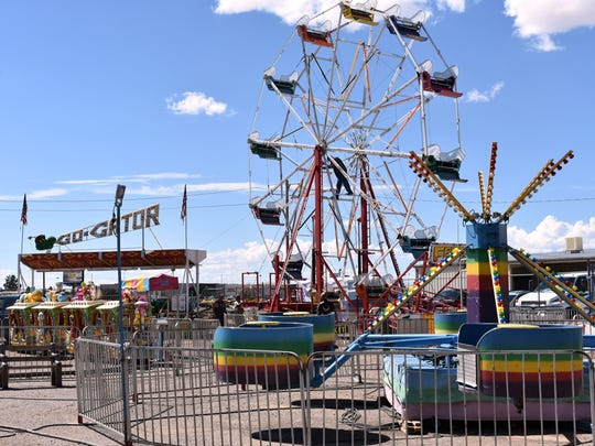 Bennett's Amusement Inc., works to set up their rides Tuesday afternoon.