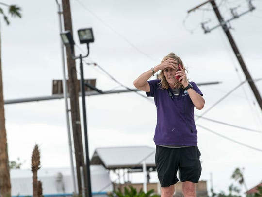 Port Aransas, Texas, resident Heather Miller, 53, reacts