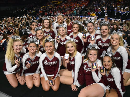 Members of Stuarts Draft's competition cheer team show off their gold medals after winning the Class 2 state title at the VHSL Cheer Championships on Saturday, Nov. 4, 2017, at the Siegel Center in Richmond, Va.