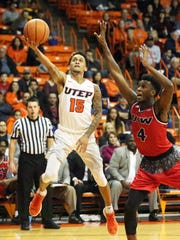 UTEP freshman guard Kobe Magee, 15, goes for a layup