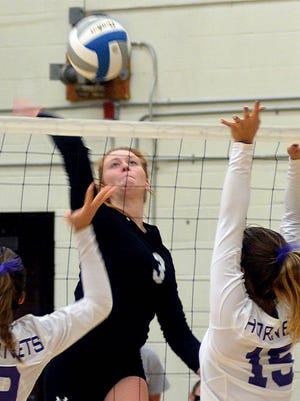 Garden City High School's Abby Ellerman goes up for a kill in a volleyball match Saturday during a tournament at Newton.