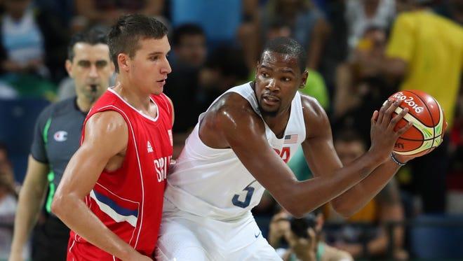U.S. forward Kevin Durant (5) looks for room to work against Serbia defender Bogdan Bogdanovic (7).