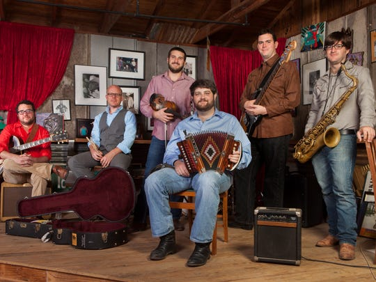Cypress Lake High graduate Chris Miller (far right) was up for a Grammy Award on Monday with his band The Revelers. They lost to Jon Cleary.