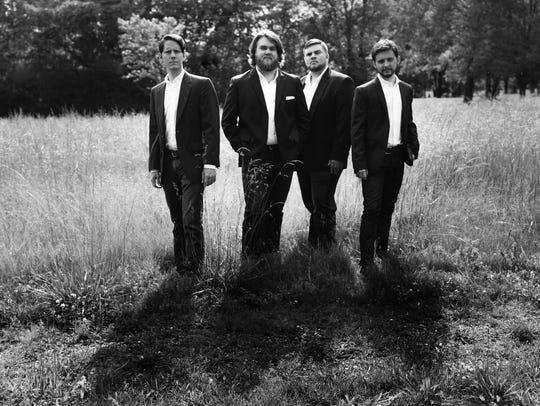 Taylor Ivey, second from left, and his three groomsmen