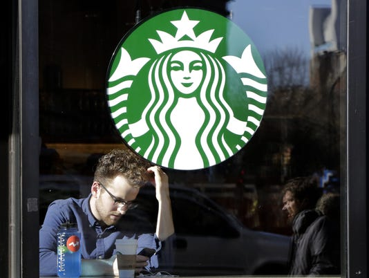 AP EARNS STARBUCKS F USA NY