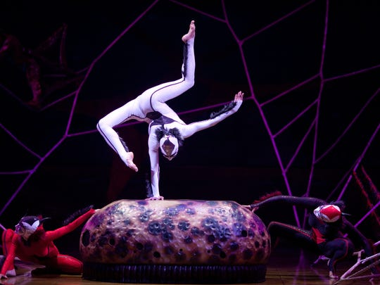 "Cirque du Soleil's ""OVO"" is populated by a fanciful array of insects designed by noted Canadian costume designer Liz Vandal. Here, we see a trio of colorful spiders."