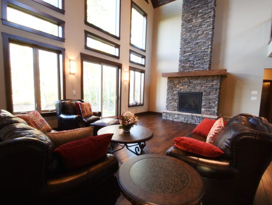 Big windows and a stone fireplace are features of