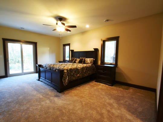 The master bedroom is on the main floor of at the five-bedroom, four-bathroom home at 11043 West Lake Road near Rice.