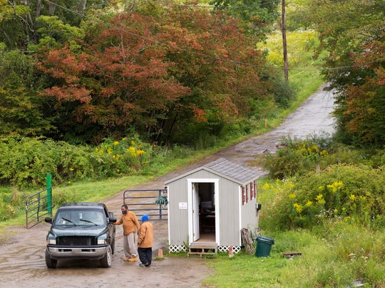 In this Sept. 7, 2017 photo, a pickup truck stops at a security post for the Muslim enclave of Islamberg in Tompkins, N.Y.