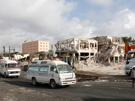Ambulances carrying wounded victims pass the scene of Saturday's truck bomb blast as they head to airport to be airlifted for treatment in Turkey, in Mogadishu, Somalia, Monday, Oct, 16. The death toll from Saturday's truck bombing in Somalia's capital now exceeds 300, the director of an ambulance service said Monday.