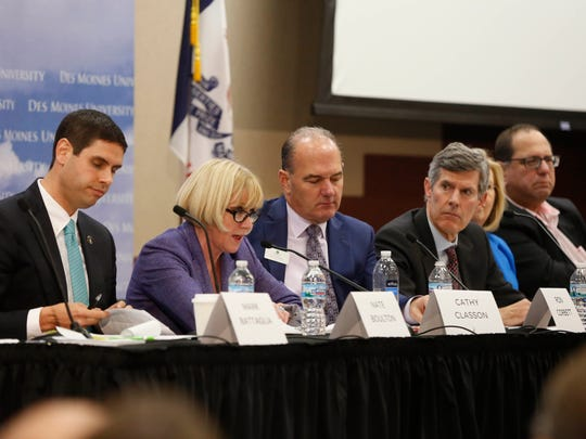 Cathy Glasson (second from left) answers a question as candidates for governor participate Tuesday, Dec. 5, 2017, at the Register's mental health forum at Des Moines University.