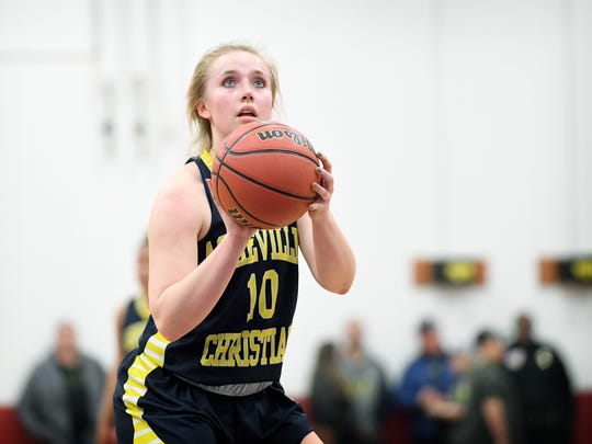 Asheville Christian Academy's Emma Newton shoots a free throw during the Lions' game at Carolina Day School on Friday, Jan. 5, 2018. The Wildcats defeated the Lions 49-41.