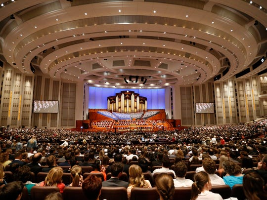 People attend the twice-annual conference of The Church of Jesus Christ of Latter-day Saints Saturday, March 31, 2018, in Salt Lake City.