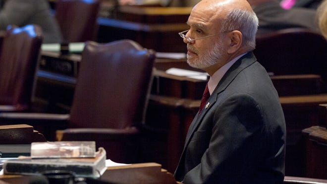 Rep. Sabi Kumar, R-Springfield, listens to a House floor debate Tuesday, April 14, 2015, in Nashville, Tenn., about a proposal to make the Bible the official book of Tennessee. A sometimes raucous floor debate followed a legal opinion issued by state Attorney General Herbert Slatery that said the bill would violate separation of church and state provisions in both the state and federal constitutions. (AP Photo/Erik Schelzig)
