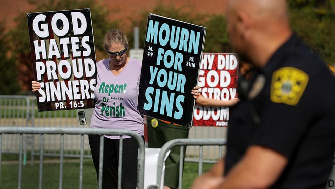 A handful of protesters from the Westboro Baptist Church showed up to protest the Indiana University – Purdue University Indianapolis LGTBQ+ Center in October 2016.
