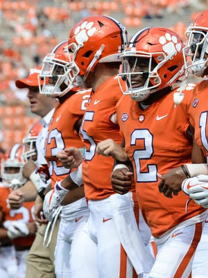 Clemson quarterback Kelly Bryant(2) and teammates walk together before kickoff with Boston College on Saturday, September 23.