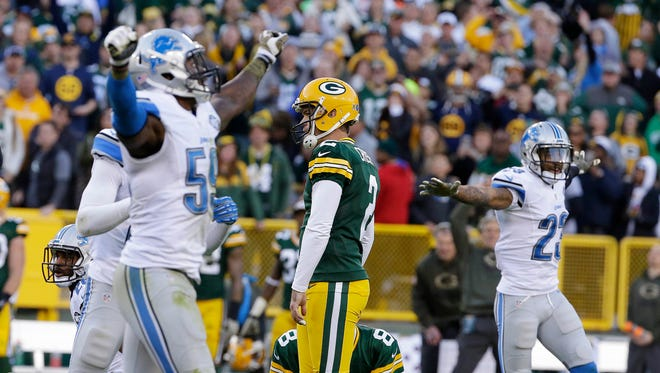 Packers kicker Mason Crosby reacts after missing a game-winning field goal during the Packers' 18-16 loss to the Detroit Lions on November 15, 2015 at Lambeau Field.