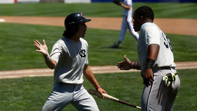 Colton Nighthawks' Patrick Keller is greeted by teammate Jason Wallace after scoring a run against  D-BAT Elite 18U on Sunday in Game 7 of the Connie Mack World Series at Ricketts Park in Farmington.