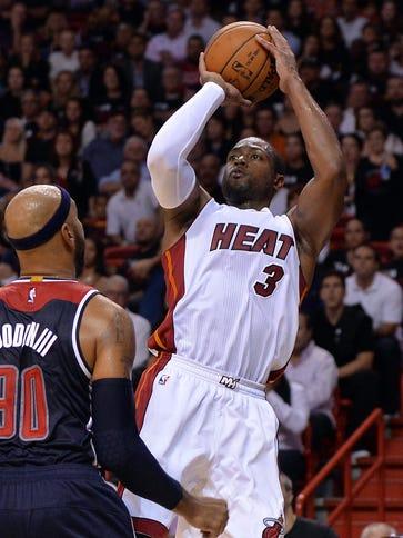 Dwyane Wade scored 21 points in the Heat's season-opening