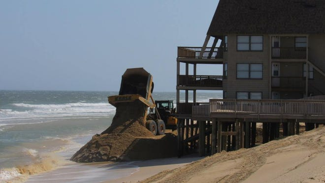 Toms River contractor Earle Asphalt dumps more sand on the beach at Ortley Beach April 12.