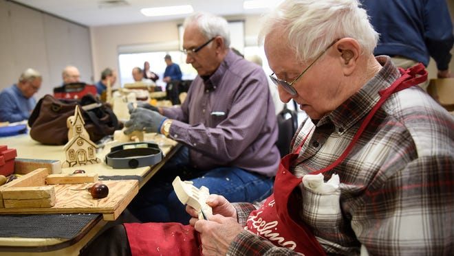 Seniors concentrate on woodcarving projects during a class Tuesday, Oct. 25, at the Whitney Senior Center. St. Cloud recently received a grant from the Act on Alzheimer's project to strengthen safety and quality of life for people with dementia. Experts say strengthening programming that already exists at Whitney Senior Center is one way to accomplish that goal.