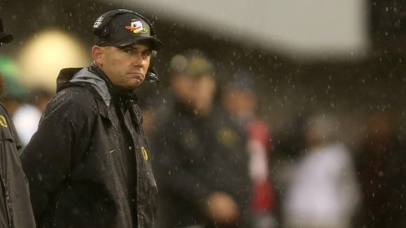 Oregon head coach Mark Helfrich watches the second half of the Oregon vs. Oregon State Civil War football game at Oregon State University in Corvallis on Saturday, Nov. 26, 2016. The Beavers won the game 34-24.