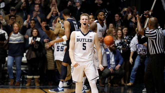 Butler Bulldogs guard Paul Jorgensen (5) begins to celebrate with win following their game at Hinkle Fieldhouse Saturday, Dec. 30, 2017. The Butler Bulldogs defeated the Villanova Wildcats 101-93.