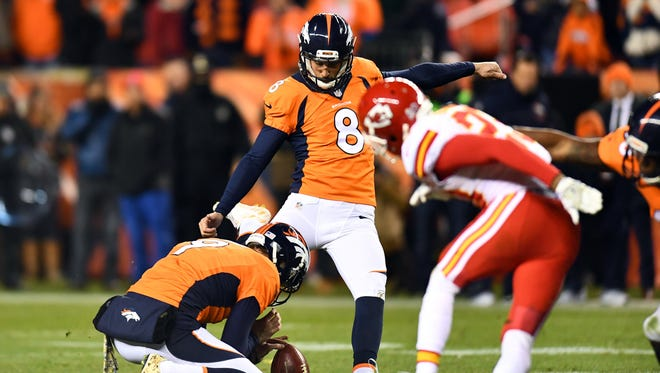 Nov 27, 2016; Denver, CO, USA; Denver Broncos kicker Brandon McManus (8) attempts and misses a 62-yard field goal in overtime against the Kansas City Chiefs at Sports Authority Field at Mile High. The Chiefs defeated the Broncos 30-27 in overtime.