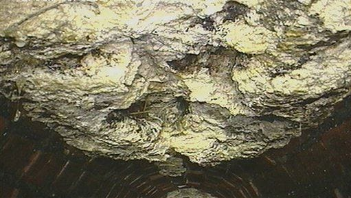 An undated image released by Thames Water company shows part of a 15-ton lump of fat inside a London city sewer.