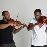 """Black Violin features Kevin """"Kev Marcus"""" Sylvester (left) on violin and Wilner """"Wil B"""" Baptiste on viola."""