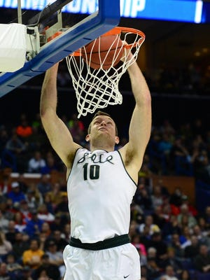 Mar 18, 2016; St. Louis, MO, USA; Michigan State Spartans forward Matt Costello (10) dunks during the second half of the first round against the Middle Tennessee Blue Raiders in the 2016 NCAA Tournament at Scottrade Center. Mandatory Credit: Jeff Curry-USA TODAY Sports