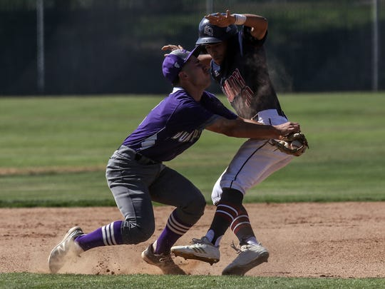 La Quinta's Miles Dille is tagged by Jurupa Hills'