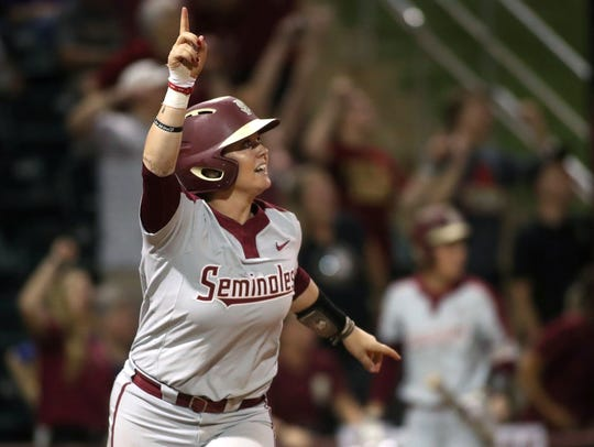 FSU's Jessie Warren watches her home run sail over the wall against LSU.