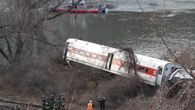 A New York commuter train derails Sunday morning in the Bronx, killing four.