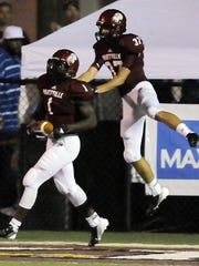 Prattville's Kamryn Pettway (1) and Seth Knotts celebrate after a touchdown during the game at Stanley Jensen Stadium in Prattville, Ala., on Friday, Sept. 14, 2012. (Montgomery Advertiser, Amanda Sowards)