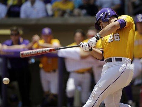LSU's Chris Chinea (26) hits a line drive RBI double in the second inning of a game against UNC Wilmington at the Baton Rouge Regional Monday.