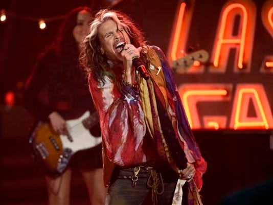 FILE - In this May 13, 2015 file photo, Steven Tyler performs at the American Idol XIV finale in Los Angeles. Tyler will be performing along with country band Loving Mary at the inaugural Pilgrimage Music & Cultural Festival in Tennessee.