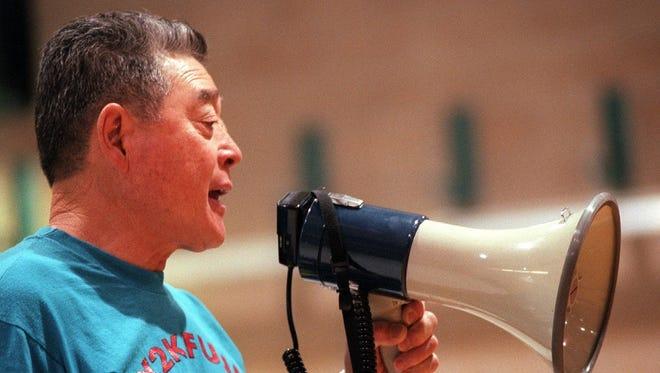 A file photo of Ken Fujii directing a basketball camp