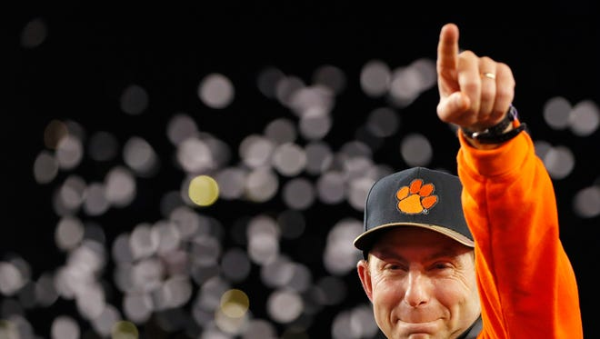 TAMPA, FL - JANUARY 09:  Head coach Dabo Swinney of the Clemson Tigers reacts after defeating the Alabama Crimson Tide 35-31 to win the 2017 College Football Playoff National Championship Game at Raymond James Stadium on January 9, 2017 in Tampa, Florida.  (Photo by Kevin C. Cox/Getty Images) ORG XMIT: 686857421 ORIG FILE ID: 631372662