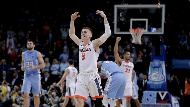 Virginia guard Kyle Guy (5) celebrates as the final seconds wind off the clock against North Carolina in the championship game of an NCAA college basketball game during the Atlantic Coast Conference men's tournament Saturday in New York.