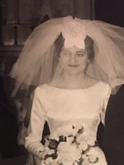 Georgia Buchanan's 1963 wedding gown, with its bateau neckline, long sleeves and fairly straight skirt is being transformed by Sandra Ashford for Buchanan's grandaughter into the wedding dress of her dreams.