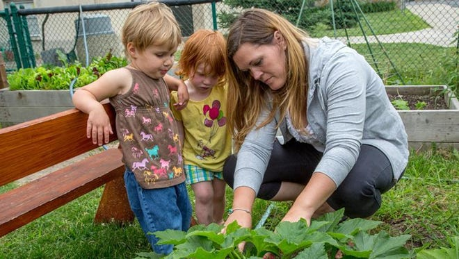 The University Child Learning and Care Center has a garden with beans climbing a teepee, several raised beds growing beets, greens, potatoes, cucumbers, squash and more.