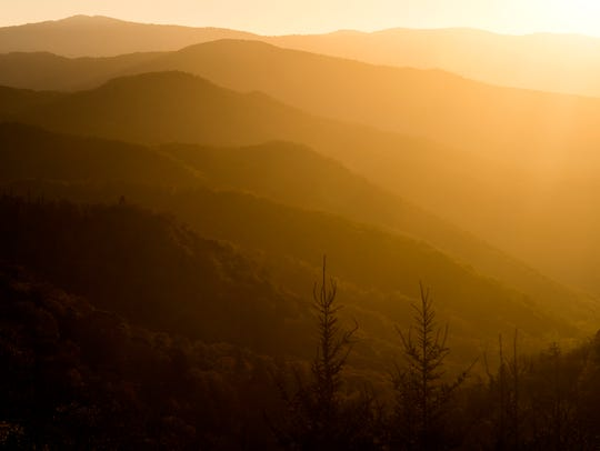 The sun rises over the Smoky Mountains as seen from