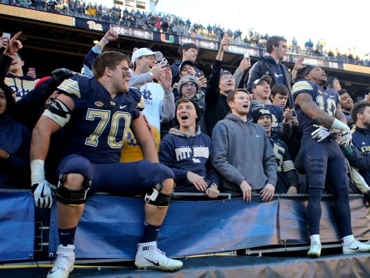 Pittsburgh offensive tackle Brian O'Neill (70) and wideout/returnman Quadree Henderson (10), both Delaware natives who attended Salesianum and A.I duPont High School, respectively, celebrate with fans in the student section last season. Both are expected to be drafted by NFL teams this week.