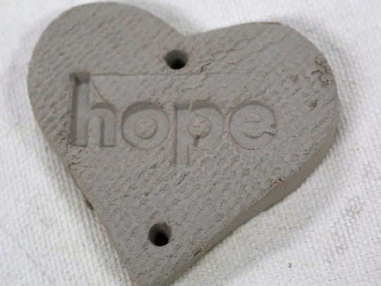 A clay heart for Hope's Hearts chimes waiting to be