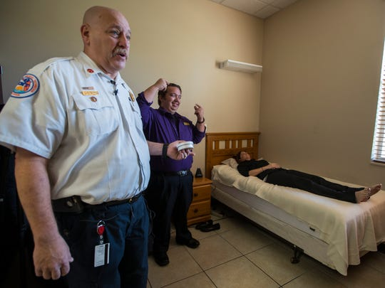 Fire marshal C. David Raborn, left, of the Cape Coral