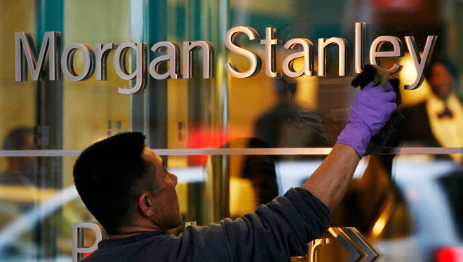 A window washer cleans off the lettering at Morgan Stanley headquarters in New York.