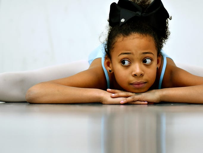 Dance student Gabriella Hernandez, 10, does the splits