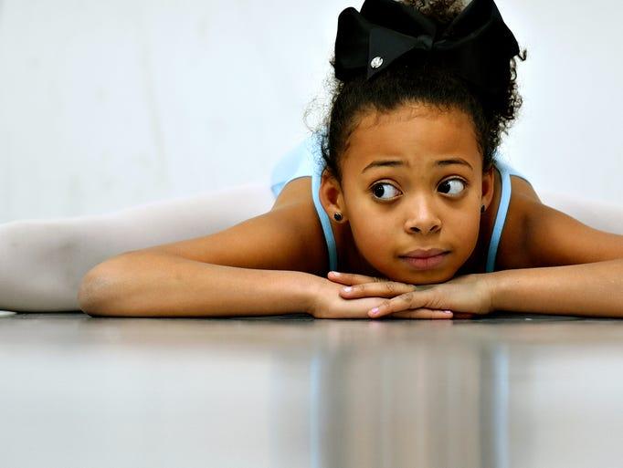 Dance student Gabriella Hernandez, 10, does the splits